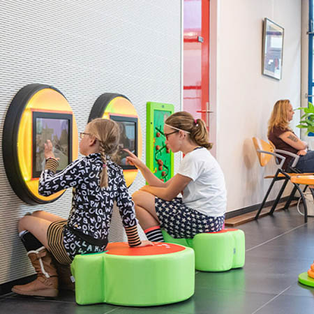 this image shows a kidscorner with virtual play system in healthcare
